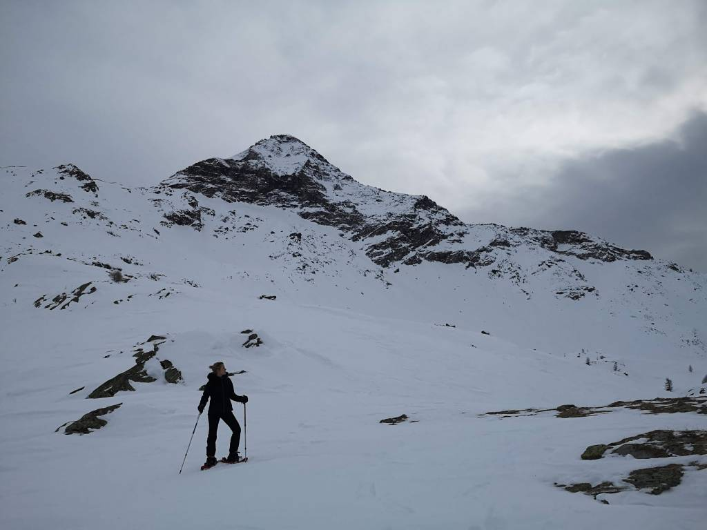 snowshoe winter hiking in valtellina, lombardy, Italy.