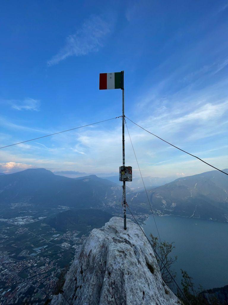 Italian flag at the top of the via ferrata in Riva del Garda